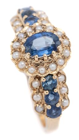 Sale 9194 - Lot 524 - A VICTORIAN STYLE SAPPHIRE AND PEARL RING; central cluster features a blue oval cut sapphire surrounded by seed pearls to shoulders...
