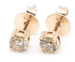 Sale 9253J - Lot 425 - A PAIR OF 14CT GOLD DIAMOND STUD EARRINGS; each claw set with a round brilliant cut champagne diamond of approx. 0.20ct P1, width 3....