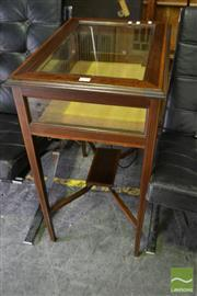 Sale 8500 - Lot 1027 - Edwardian Mahogany and Cross Banded Vitrine Table Enclosing a Gold Velvet Interior and on Tapering Legs with Small Shelf