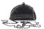 Sale 8857 - Lot 389 - A BLACK CRYSTAL COCKTAIL PURSE; with fold away gunmetal tone chain, 12 x 4 x 9cm, with spare crystals.