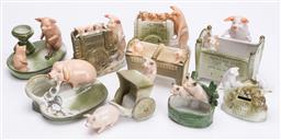 Sale 9185E - Lot 156 - A collection of pigs figural groups, with losses, tallest Height 11.5cm