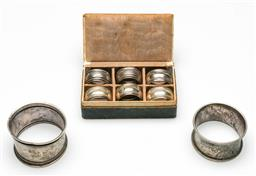 Sale 9209 - Lot 41 - A collection of six (800) silver napkin rings and two others