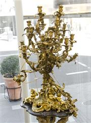 Sale 8205 - Lot 78 - A magnificent Rococo style 18 branch gilt metal candelabrum with cherubs and fruit, fitted for electricity, H 95cm