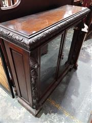 Sale 8714 - Lot 1036 - Late Victorian Carved Oak Dwarf Bookcase, with two glass panel doors flanked by pine & fruit carved fascia (key in office)