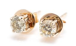 Sale 9253J - Lot 427 - A PAIR OF 14CT GOLD DIAMOND STUD EARRINGS; each claw set with a round brilliant cut light yellow diamond of approx. 0.20ct, P (1 chi...