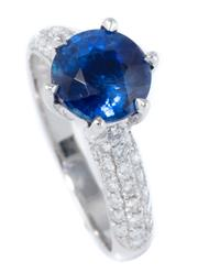 Sale 8937 - Lot 466 - AN 18CT WHITE GOLD KYANITE AND DIAMOND RING; claw set with a round cut 1.6ct kyanite above shoulders set with round brilliant cut di...