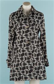 Sale 9071F - Lot 91 - A BLACK AND WHITE CHAIN DETAIL JACKET with interlocking buttons, long sleeves and fastening to cuffs Size S