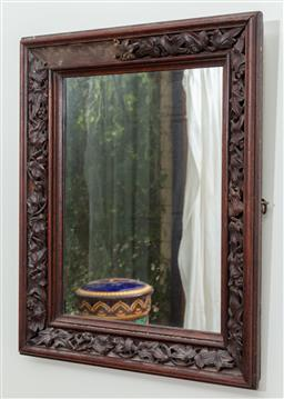 Sale 9120H - Lot 270 - A mahogany framed maple leaf themed mirror, 52cm x 42cm losses to frame