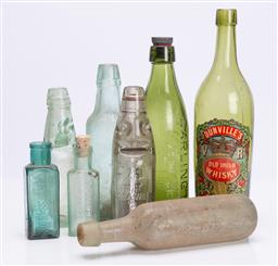 Sale 9185E - Lot 49 - A collection of blue and green glass bottles, tallest Height 30cm
