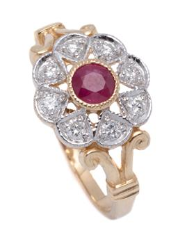 Sale 9194 - Lot 381 - AN EDWARDIAN STYLE RUBY AND DIAMOND CLUSTER RING; set in 9ct gold with central round cut treated ruby to surround of 8 round brillia...