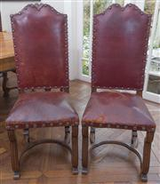 Sale 8470H - Lot 156 - A set of six Louis XIV style oak high back dining chairs upholstered in studded maroon leather with stretcher base