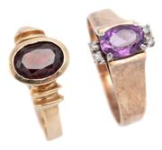 Sale 9074 - Lot 313 - TWO 9CT GOLD STONE SET RINGS; one set with an oval cut amethyst and 4 single cut diamonds between upswept shoulders, other a rub set...