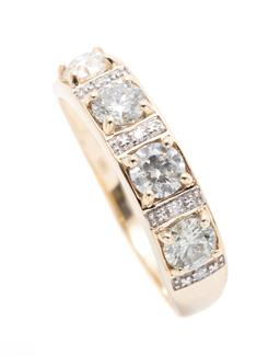 Sale 9253J - Lot 419 - A 14CT GOLD DIAMOND RING; 5mm wide band set across the top with 9 round brilliant cut diamonds totalling approx. 0.98ct P1 (1 drille...