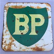 Sale 8579 - Lot 59 - A BP petrol station double sided sign with rust and bullet holes, H 115 x W 115cm
