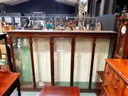 Sale 8693 - Lot 1035 - Late 19th/ Early 20th Century Large Shop Display Cabinet, having five arched panel doors, with some glass shelves, according to vend...