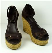 Sale 8460F - Lot 55 - A pair of chocolate brown leather Ralph Lauren wedge espadrilles, slight wear, size 7