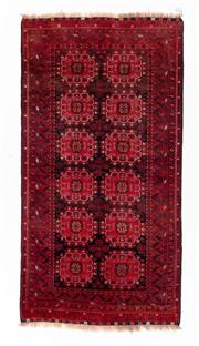 Sale 8800C - Lot 157 - A Persian Baluchi Tribal Hand Knotted Wool Rug, 105 x 205cm
