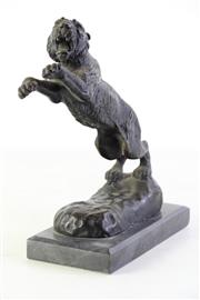 Sale 8989 - Lot 20 - Bronze on marble of A Leaping Tiger (H: 27cm)