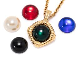 Sale 9168J - Lot 321 - A KENNETH LANE PENDANT NECKLACE WITH INTERCHANGEABLE STONES; gold tone pendant with 19mm round resin cabochons in red, blue, green,...