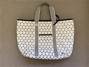 Sale 8694A - Lot 69 - A Lacoste white and navy patterned canvas tote bag with striped handles, H 38 x W 51cm