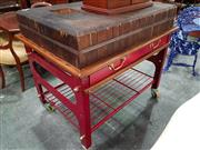Sale 8792 - Lot 1031 - A large Gordon Marr & Sons, Sydney butchers block, the massive block top on a red painted cast iron base, fitted with four drawers...