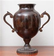 Sale 8902H - Lot 37 - A patinated metal urn with two handles on a fluted pedestal, Height 26cm