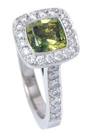 Sale 8980J - Lot 84 - An 18ct White Gold Sapphire and Diamond Ring; centring cushion cut green saphire to surround, gallery and shoulders set with 46 roun...