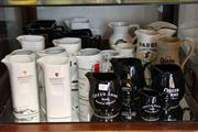 Sale 8014 - Lot 80 - Wade Queen Anne Whisky Jugs, Old Smuggler & Others