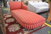 Sale 8291 - Lot 1072 - Chaise Longue, in red striped fabric, on turned timber legs and brass castors