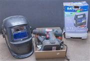 Sale 8550H - Lot 252 - A group of wares including a welding mask, battery charger, cordless drill, two glue guns and others