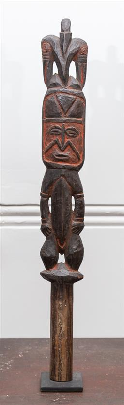 Sale 9160H - Lot 81 - An early 20th century PNG Abelam carved old yam digging stick finial in the form of an ancestral figure with bird headdress, with re...