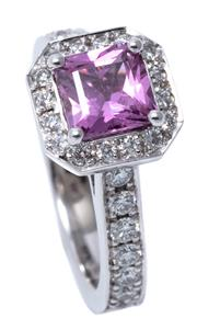 Sale 8980J - Lot 45 - An 18ct White Gold Sapphire and Diamond Ring; centre set with a sqaure radiant cut pink sapphire of approx. 1.35ct to surround and s...