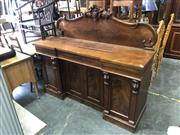 Sale 8693 - Lot 1058 - Victorian Mahogany Breakfront Sideboard, with carved back,  three drawers & four doors flanked by carved brackets