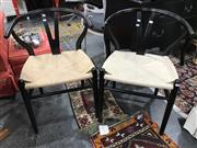 Sale 8782 - Lot 1338 - Pair of Black Wishbone Dining Chairs