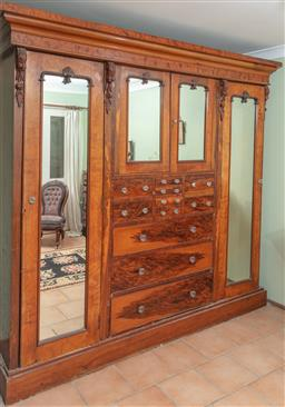 Sale 9120H - Lot 279 - Victorian walnut wardrobe of large proportions with ten drawers and four doors opening to reveal shelved interior, Height 225cm x Wi...