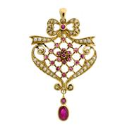 Sale 8134B - Lot 319 - AN NOUVEAU STYLE 9CT GOLD PENDANT; set with rubies and small pearls. Length 46mm.