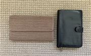 Sale 8694A - Lot 100 - Two wallets, to include a black leather Cellini example and a note wallet by the Sak