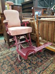 Sale 8939 - Lot 1071 - Antique Cast Iron Victory Barbers Chair, painted red & with pink upholstery, on four outswept legs. H: 128, W: 62, D: 125cm