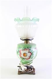 Sale 8940T - Lot 623 - Smokey glass kerosene lamp with floral decorated on green mid-senction and a green frill topped shade and smokey glass flute (H51cm)