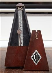 Sale 9081H - Lot 101 - A Wurlitzer antique metronome, height 32cm (small crack to wood on right hand side)