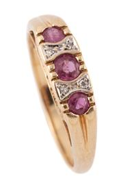 Sale 9095 - Lot 383 - A 9CT GOLD RUBY AND DIAMOND RING; set with 3 round cut rubies totalling approx. 0.35ct and 4 small single cut diamonds on ILOVEYOU p...