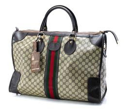 Sale 9095F - Lot 81 - A Gucci monogrammed hold all, width 50cm.