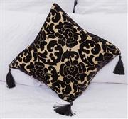 Sale 8308A - Lot 149A - A gold and cut black velvet feather filled cushion, each corner decorated with a tassel
