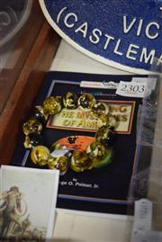 Sale 8405 - Lot 2303 - Amber Book With Amber Bracelet