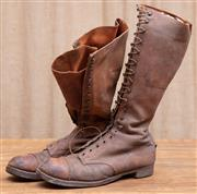 Sale 8984H - Lot 41 - A pair of early brown leather military lace up boots with leather soles and steel caps. Approx. mens size 8