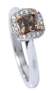 Sale 8980J - Lot 47 - An 18ct White Gold Diamond Ring; centring a radiant cut cognac diamond of 052ct C4/ P1 to surround and gallery set with 32 round bri...