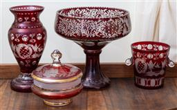 Sale 9103M - Lot 701 - Four ruby glass items to include a raised fruit bowl, a small ice bucket, a vase and lidded box. Height of fruit bowl 24cm