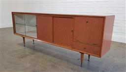 Sale 9188 - Lot 1097 - 1960s Chiswell Laminex sideboard with fall-front bar unit and sliding glass section (h:82 w:220 d:45cm)