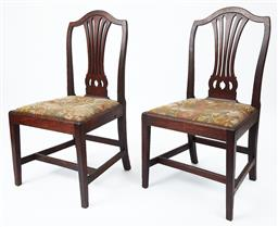 Sale 9135H - Lot 31 - A rare pair of Georgian Australian Colonial side chairs. The camel back top rail above a pierced centre splat above trap seats uphol...
