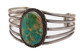 Sale 9177 - Lot 353 - A NATIVE AMERICAN TURQUOISE CUFF BANGLE SIGNED M BEGAY; 5 row wire bangle millegrain set with a 31 x 21mm oval turquoise with matrix...
